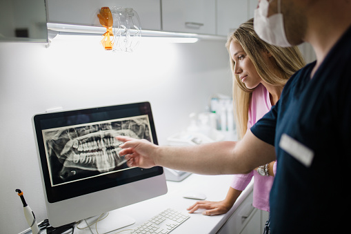 Ann Arbor dental hygienest looking over digital x-ray at Everwell Dentistry.